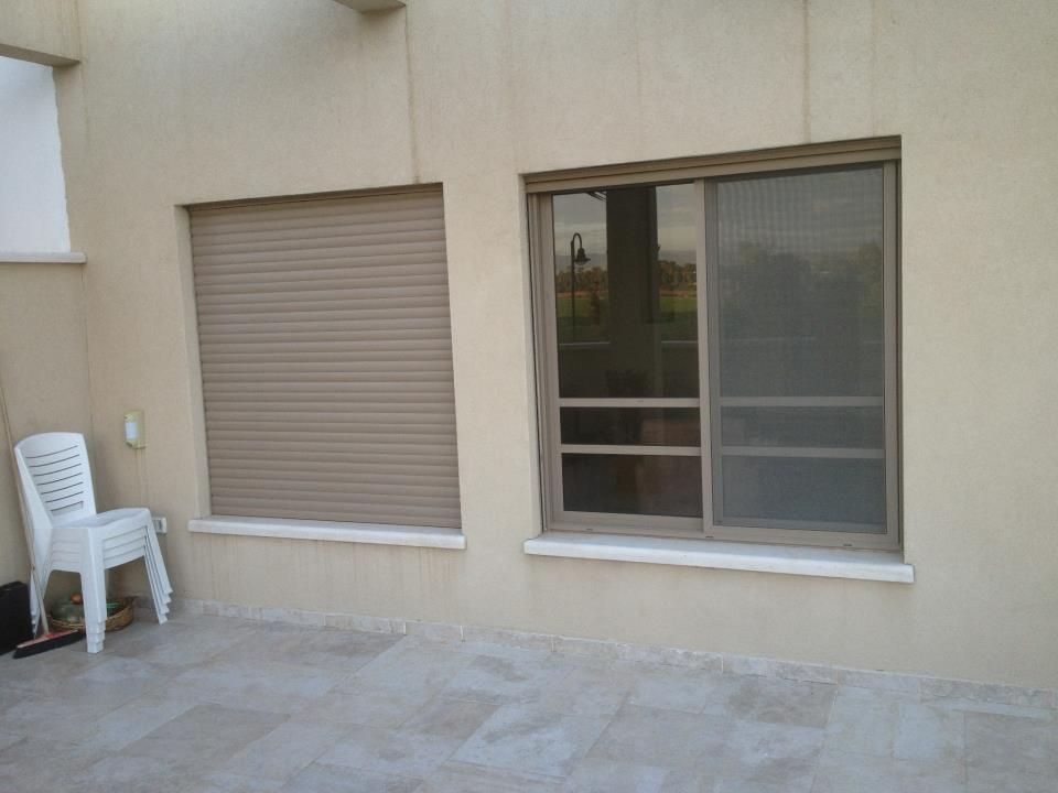 Pair-of-windows-with-electric-shutters-balcony.jpg